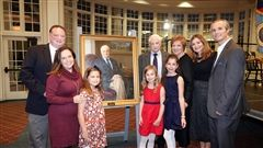 Dr. Reginald Dalle surrounded by family at the unveiling of his portrait October 24