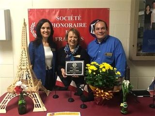 Left to right: Loyola Academy French teachers Inna McNally, Cathy Kendrigan, and Thomas Sapp hold the plaque awarded to the school for AATF Exemplary French Program with Distinction (2019-2021).