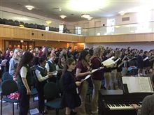 The Middle School Choir Festival brought students together from Queen of All Saints, OLPH, and St. Joan of Arc