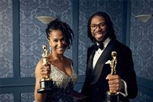 Matthew A. Cherry '99 (right) with Hair Love co-producer Karen Rupert Toliver moments after their Oscar win. (Photo courtesy Matthew Cherry on Twitter, @MatthewACherry)