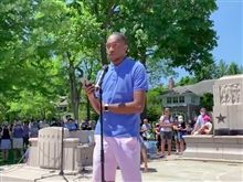Alzario Palmer '18 addresses the crowd at Winnetka Walks Against Racism in June.