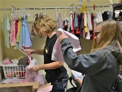 Cor Jesu students sort clothes during the all-school Service Saturday on October 6