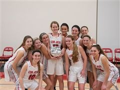 The Charger basketball team congratulates Molly Hummel on her 1000th career point