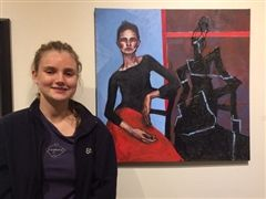 Kaitlyn Esson with her  First Place Award painting, Composure.