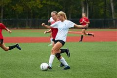 Captain Elizabeth Laub '18 in action against New Canaan High School