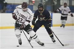 Will Pond '18 keeps the puck from his opponent in St. Luke's 3-0 win over The King School