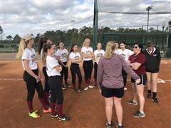 The St. Luke's Softball team receiving some pre-game instruction from the coaches.
