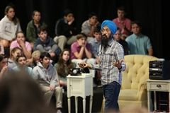 Cartoonist Vishavjit Singh meets with St. Luke's Middle School students