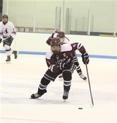 CJ Woodberry '19 scored the winning goal for St. Luke's Varsity Hockey against King School