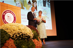 St. Luke's Head of School Mark Davis presenting award to Nancy Walsh