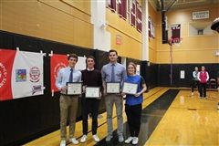 Lars Ernberg '20, Jackson McManus '20, Jack Truwit '20, and Sadie Vehslage '20 were honored by the Special Olympics president for their service