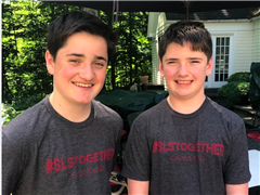 St. Luke's students, Matthew Stimpson '24  and  Henry Stimpson '25, wear #SLSTogether t-shirts benefitting Inspirica.