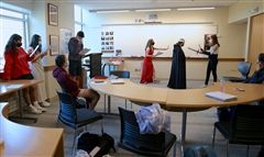 St. Luke's students act out scenes from Hamlet.