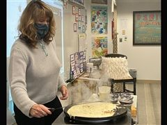 St. Luke's MS French Teacher, Cynthia Badan, demonstrates how to make crepes.