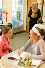 Ms. McMullen discusses a reading assignment with a Middle School student.