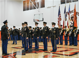 The TMI Corps of Cadets, shown here at a pass-in-review ceremony, earned Honor Unit with Distinction status after a Feb. 4 JROTC inspection.
