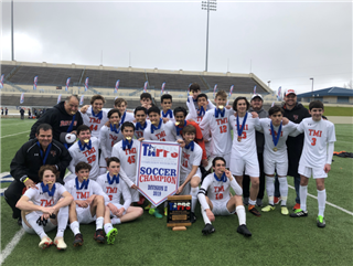 The TMI boys varsity soccer team celebrates their state championship Feb. 22 in Waco.