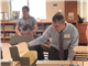 TMI teacher Kristian Marks (standing, right) looks up old documents during a workshop for educators at the Army History and Education Center archives. (Photo courtesy of the National Council for History Education)