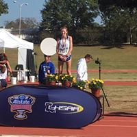 Molly McHale atop the Champions podium