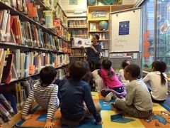 Librarian Maria Alegre reading