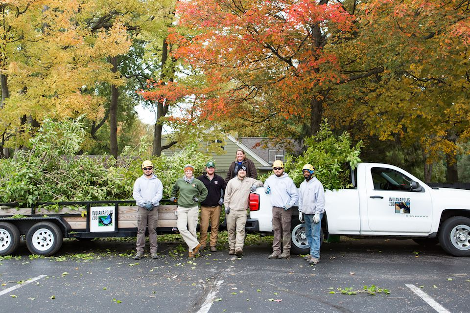 Orchard's Landscape Technician Abby Thompson (back) standing with members of Vine & Brand and the Indianapolis Zoo